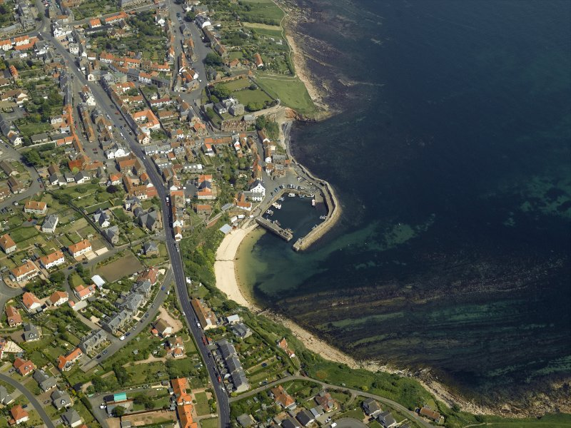 General oblique aerial view of the town centred on the harbour, taken from the SW.