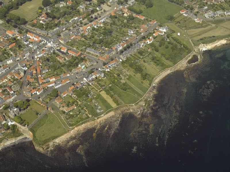 General oblique aerial view of the town centred on the library, school and hotel with the dovecot adjacent, taken from the S.