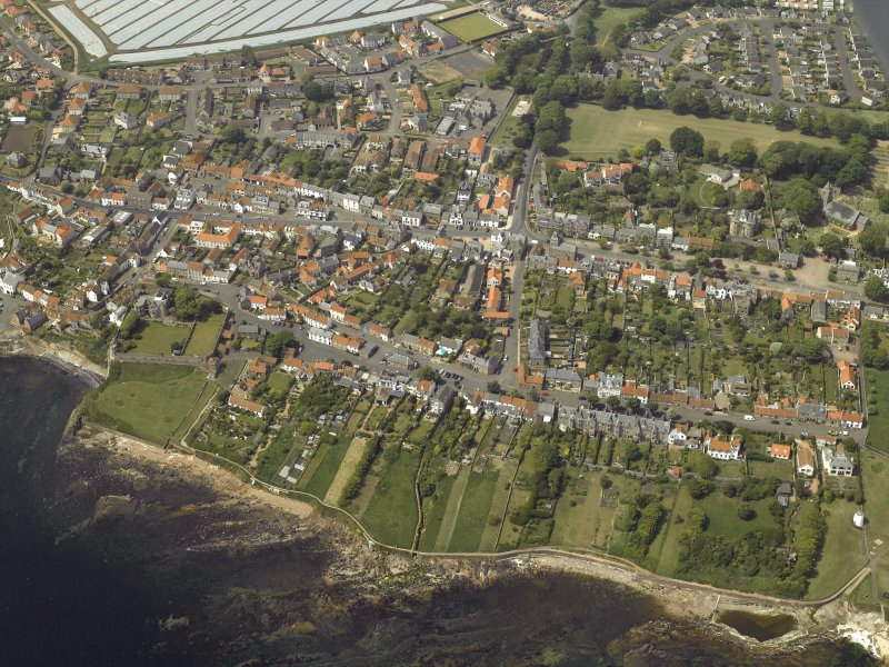 General oblique aerial view of the town centred on the library, school and hotel with the dovecot adjacent, taken from the ESE.