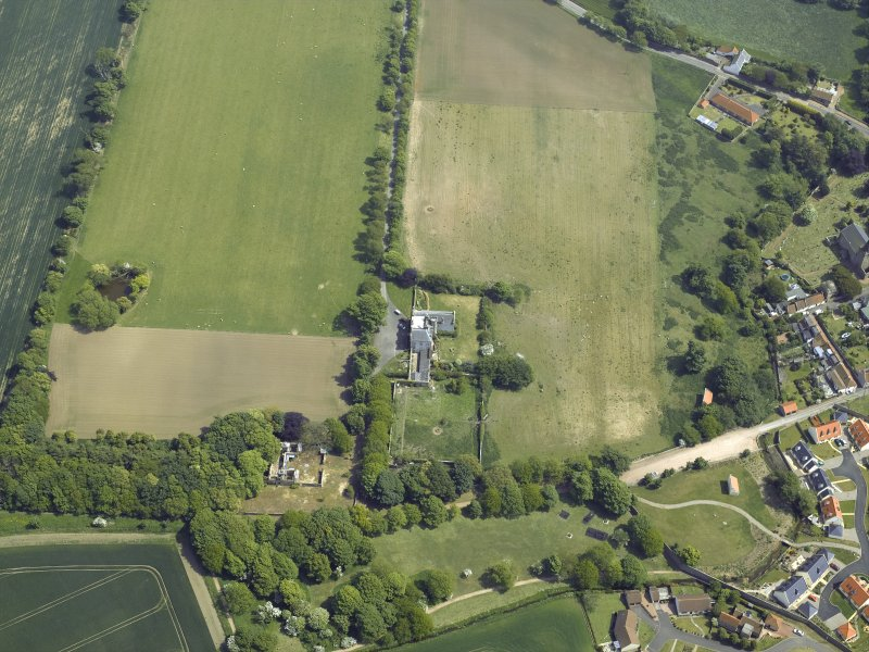 Oblique aerial view centred on the country house, garden and stables with the dovecots adjacent, taken from the W.