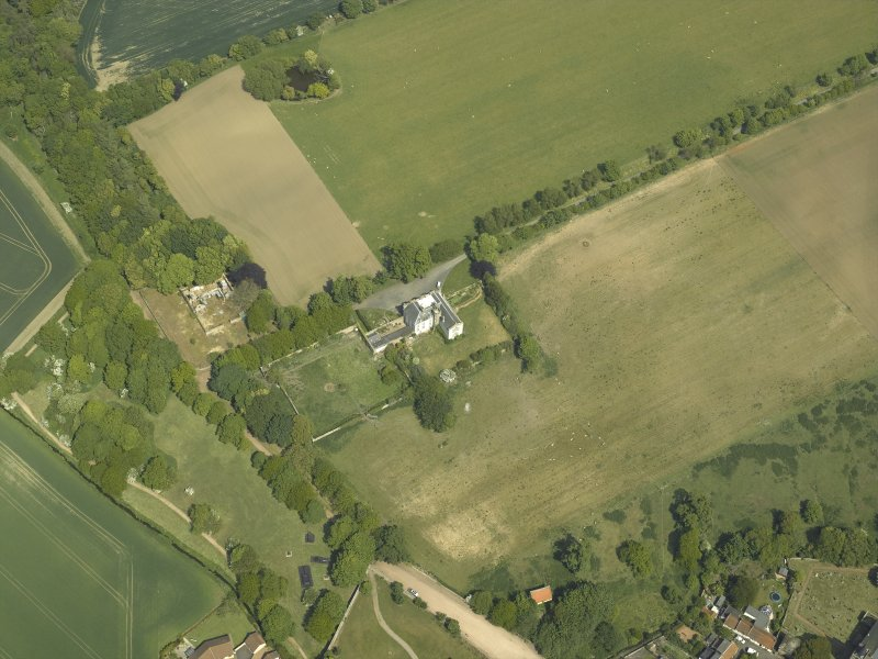 Oblique aerial view centred on the country house, garden and stables with the dovecots adjacent, taken from the SW.