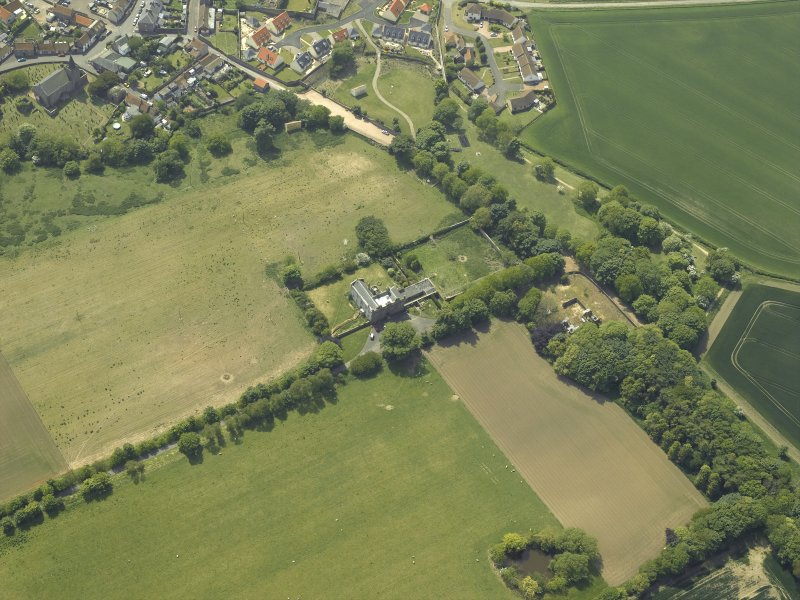 Oblique aerial view centred on the country house, garden and stables with the dovecots adjacent, taken from the NE.