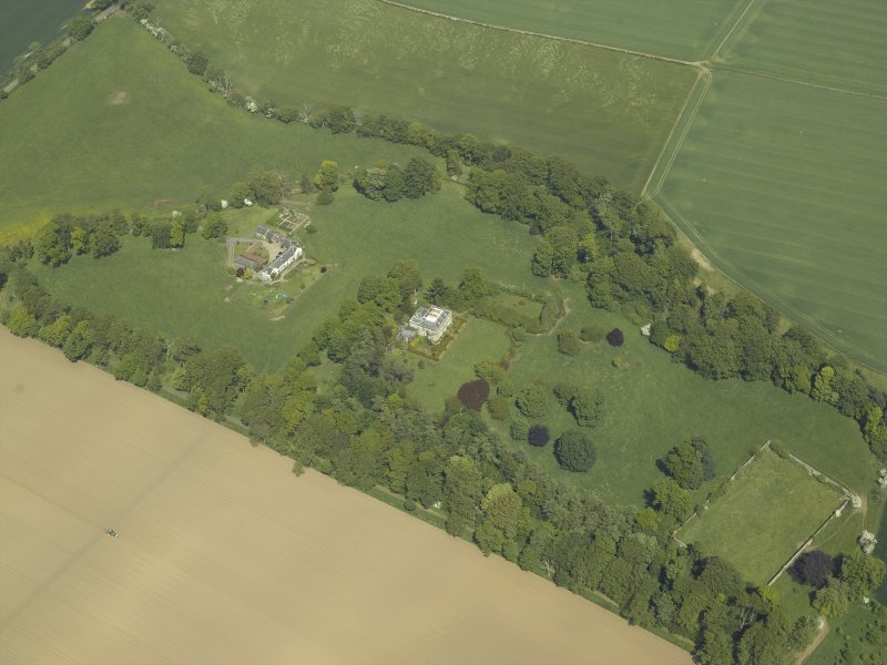 Oblique aerial view centred on the country house and stables, taken from the SW.