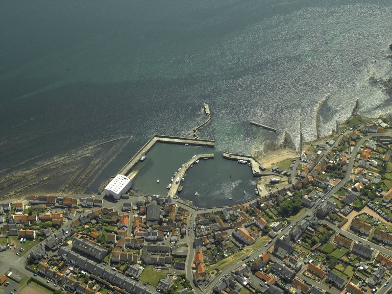 General oblique aerial view centred on the harbour, taken from the N.