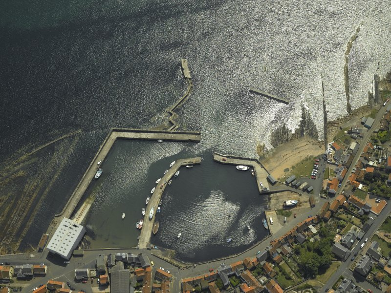Oblique aerial view centred on the harbour, taken from the NNW.