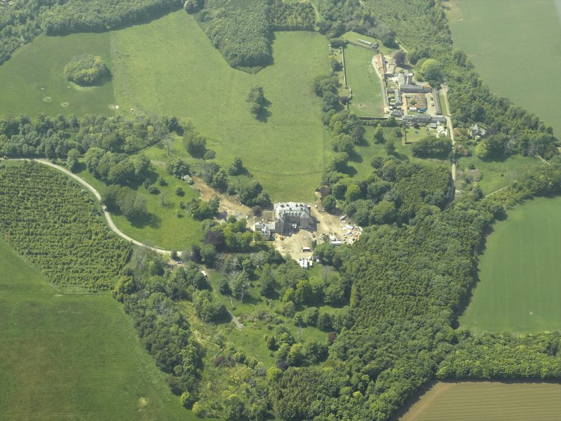 General oblique aerial view centred on the country house with the farmstead, walled garden, cottages, sawmill and dovecot adjacent, taken from the SE.