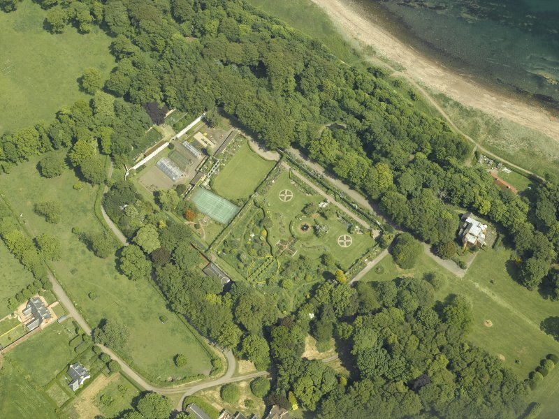Oblique aerial view centred on the walled garden and orangery with the cottages adjacent, taken from the WSW.