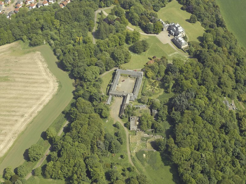 Oblique aerial view centred on the stable block and the country house, taken from the W.