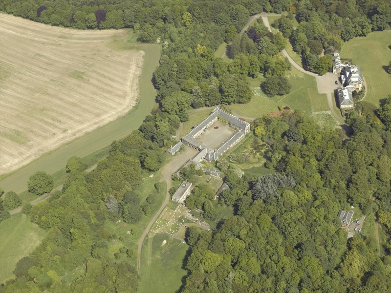 Oblique aerial view centred on the stable block and the country house, taken from the WSW.
