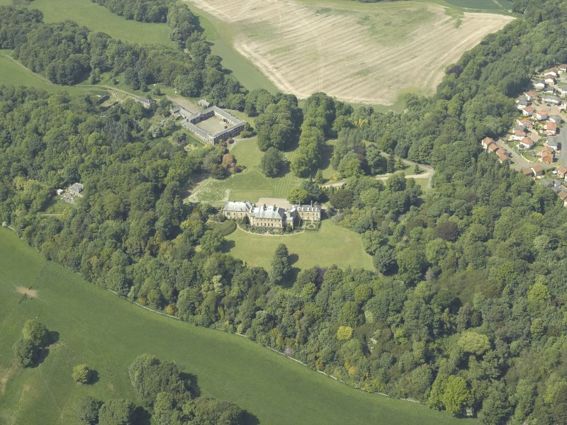 General oblique aerial view centred on the country house and stable block, taken from the SE.