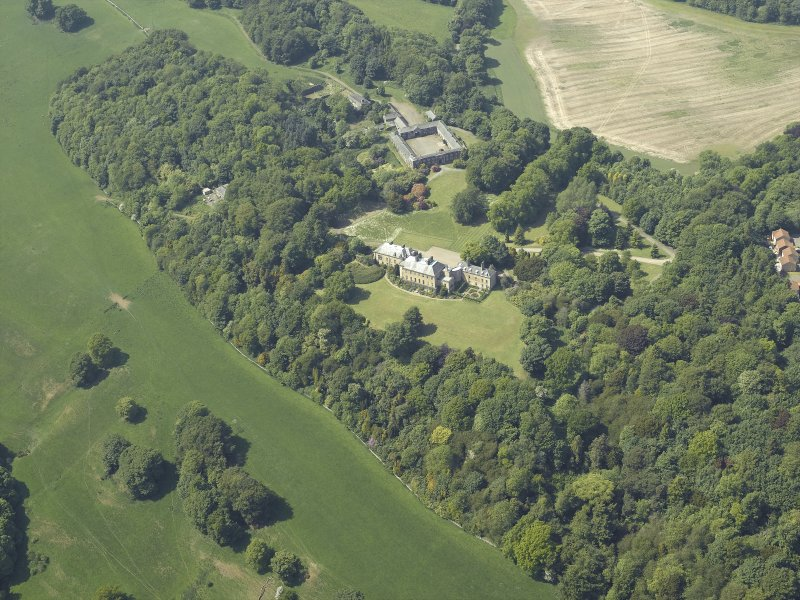 General oblique aerial view centred on the country house and stable block, taken from the ESE.