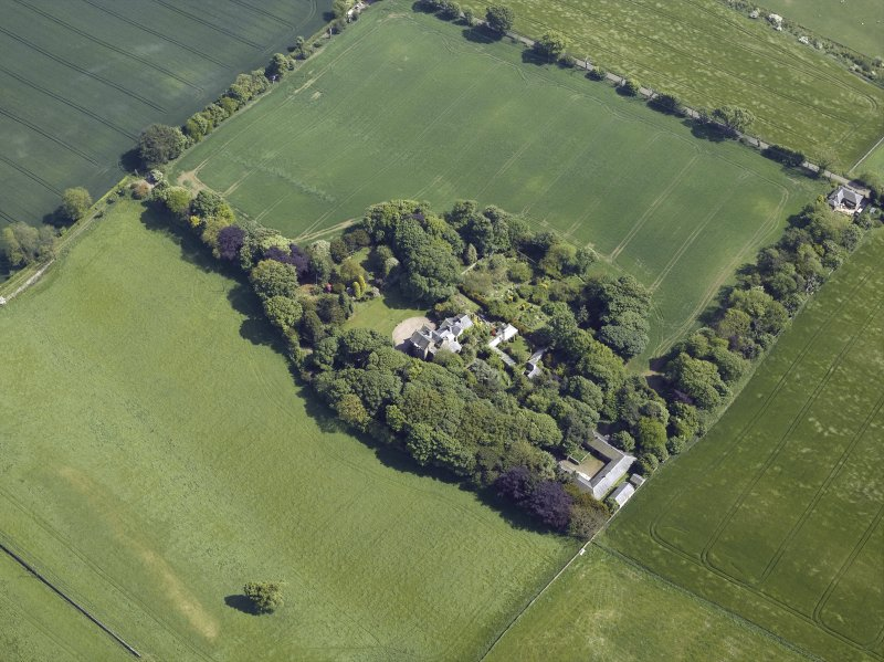 Oblique aerial view centred on the country house, conservatory, dovecot and farmsteading, taken from the NW.
