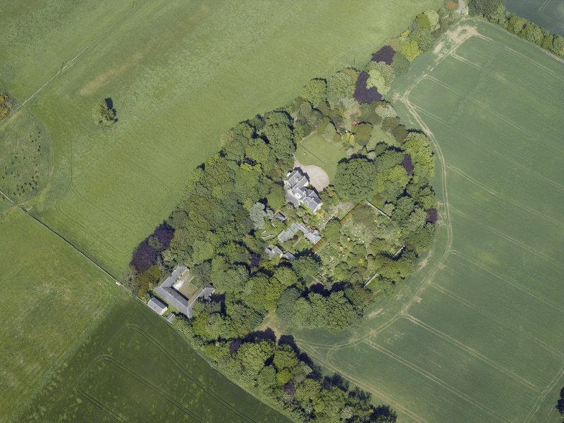 Oblique aerial view centred on the country house, conservatory, dovecot and farmsteading, taken from the SW.