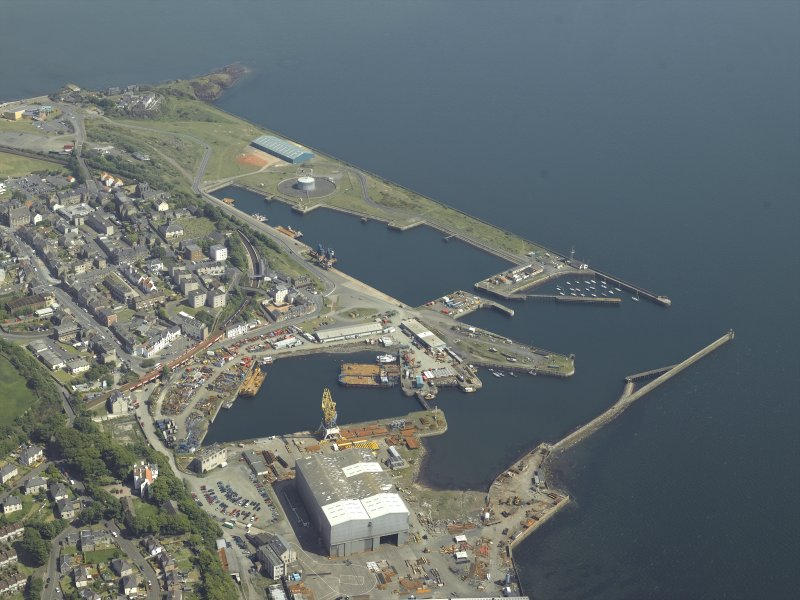 General oblique aerial view centred on the harbour, taken from the W.