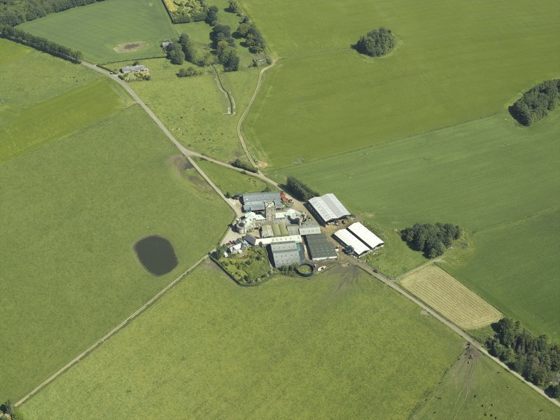 Oblique aerial view centred on the farmsteading, taken from the SW.