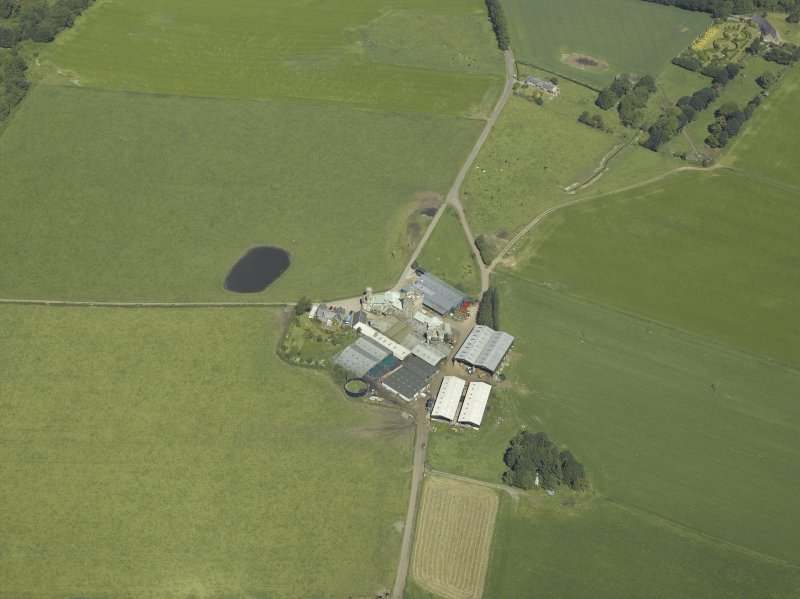 Oblique aerial view centred on the farmsteading, taken from the SE.