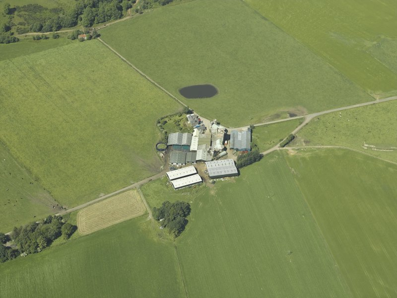 Oblique aerial view centred on the farmsteading, taken from the E.