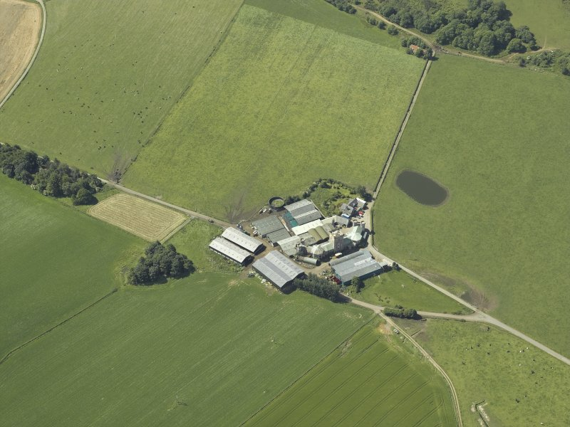 Oblique aerial view centred on the farmsteading, taken from the NE.