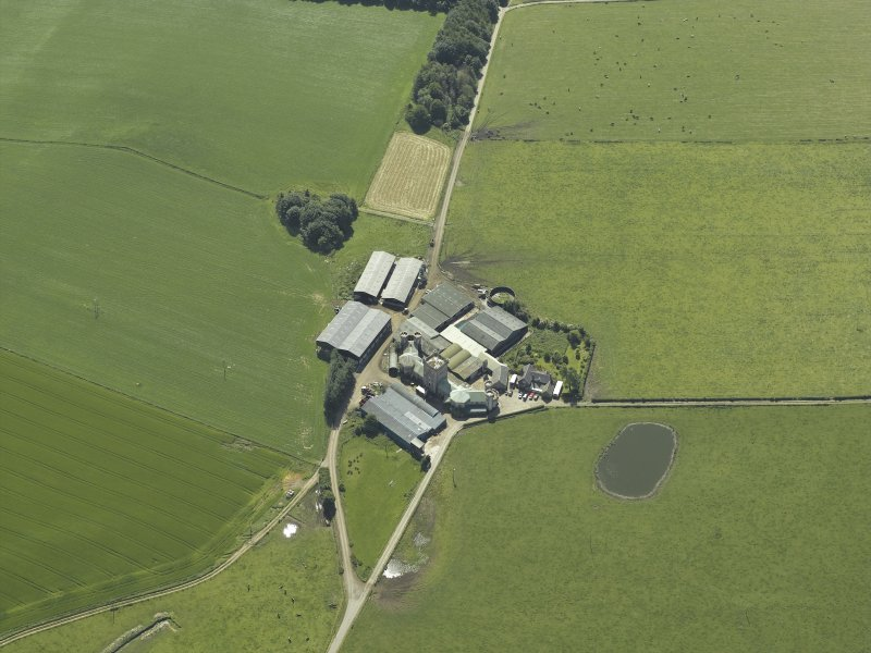 Oblique aerial view centred on the farmsteading, taken from the NNW.