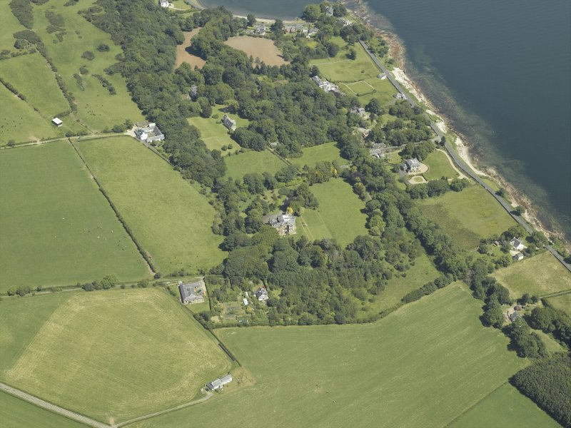 Oblique aerial view centred on the castle and country house, taken from the SW.