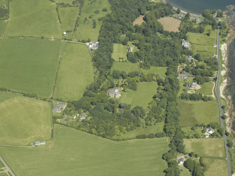 Oblique aerial view centred on the castle and country house, taken from theSSW.