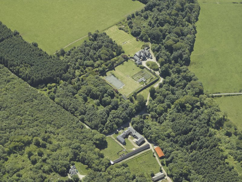 Oblique aerial view centred on the house, taken from the NW.