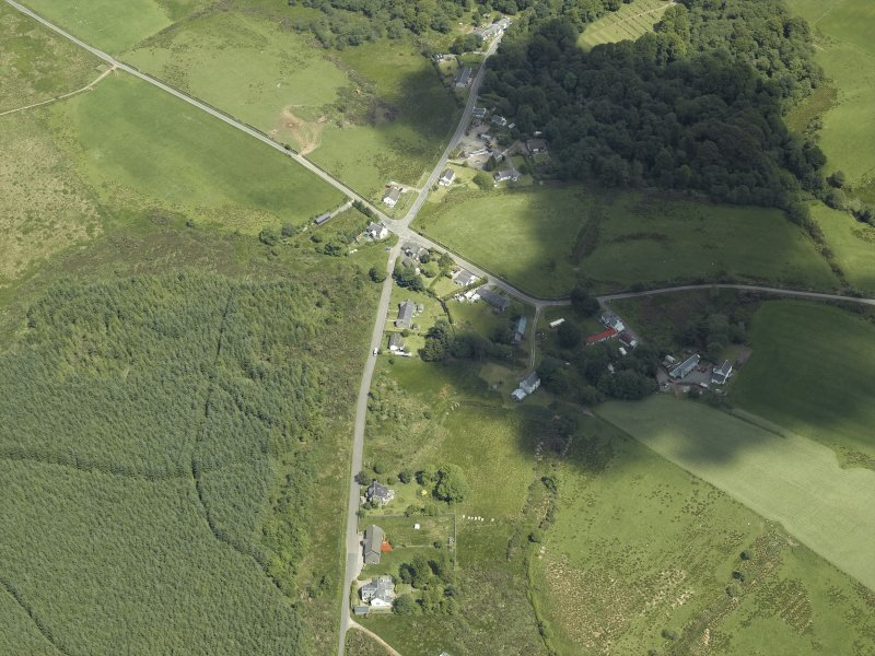Oblique aerial view centred on the township and village, taken from the SW.