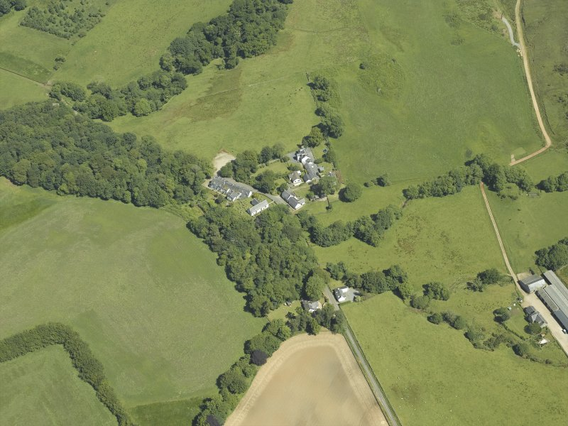 General oblique aerial view centred on the village, taken from the SW.