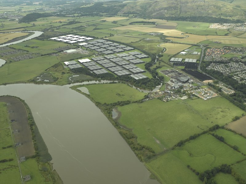 Oblique aerial view.  Tullibody, Cambus Distillery and bonded warehouses from SE.