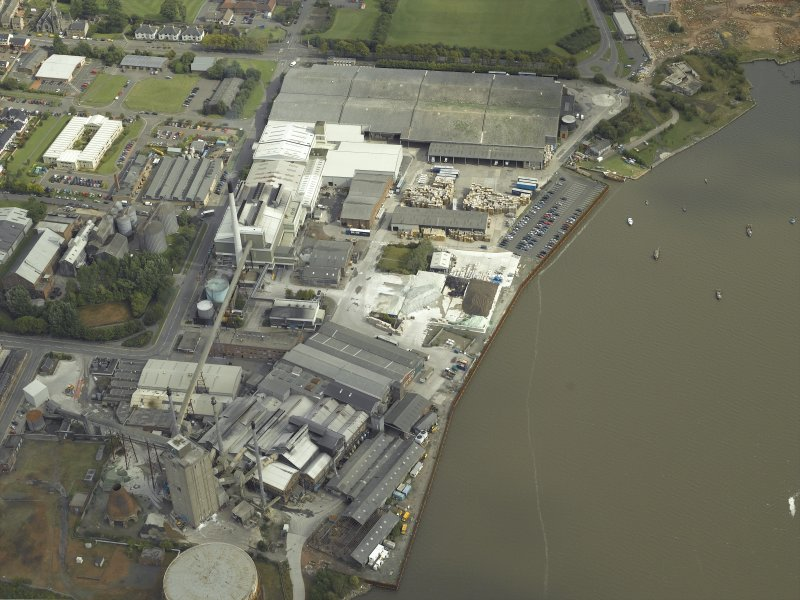 Oblique aerial view.  Alloa Glass Works, gasholder and harbour from W.