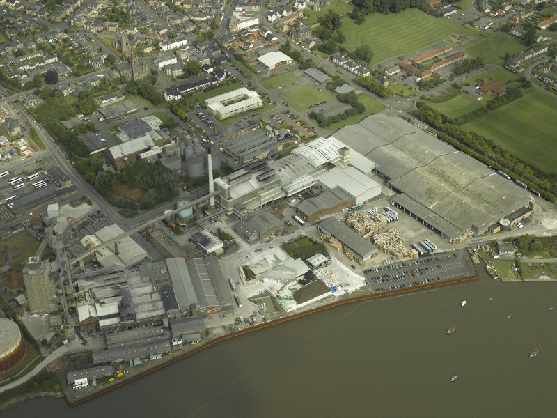 Oblique aerial view.  Alloa Glass Works, gasholder and harbour from SW.