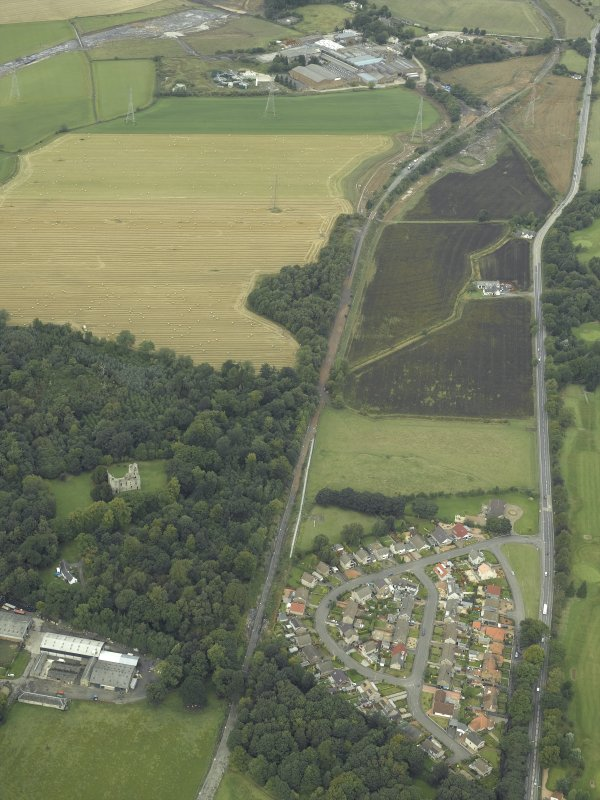 Oblique aerial view.  Reconstruction works for rebuilding railway from Alloa, Old Tulliallan Castle, Hawkhill and Kilbagie in the background from S.