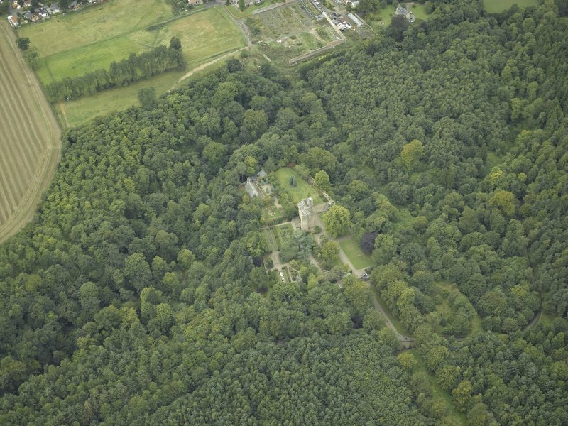 Oblique aerial view centred on the castle, garden and chapel, taken from the ESE.