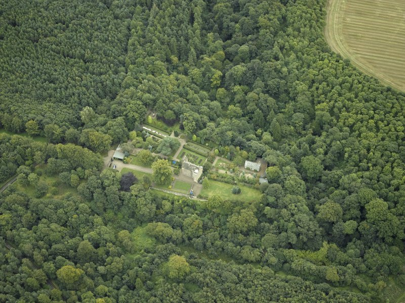 Oblique aerial view centred on the castle, garden and chapel, taken from the NW.
