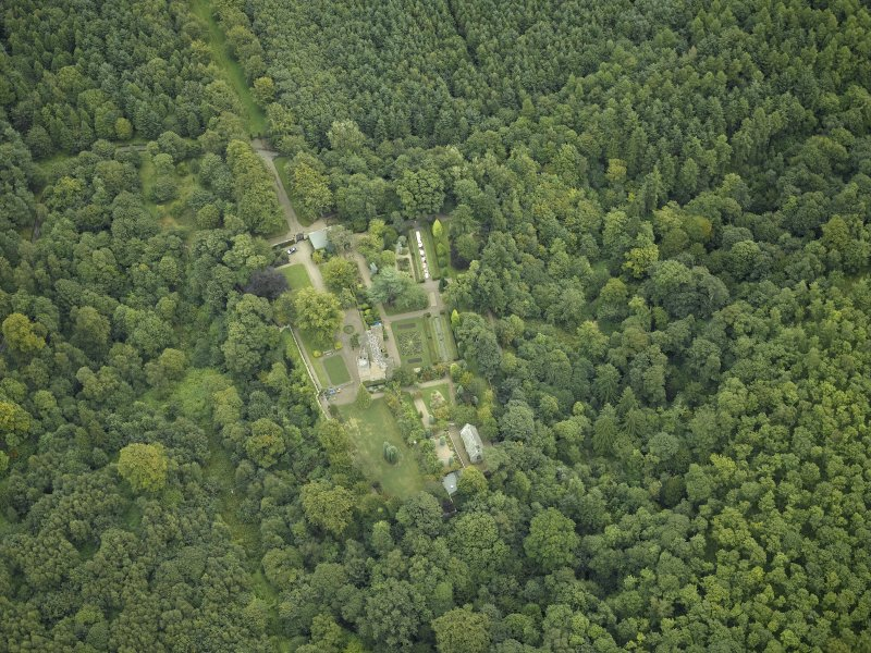 Oblique aerial view centred on the castle, garden and chapel, taken from the W.