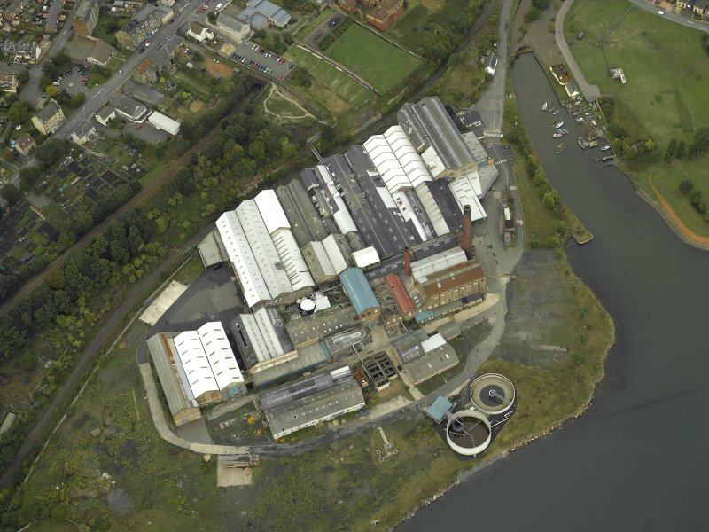 Oblique aerial view centred on the paper mill and saltworks, taken from the SSE.