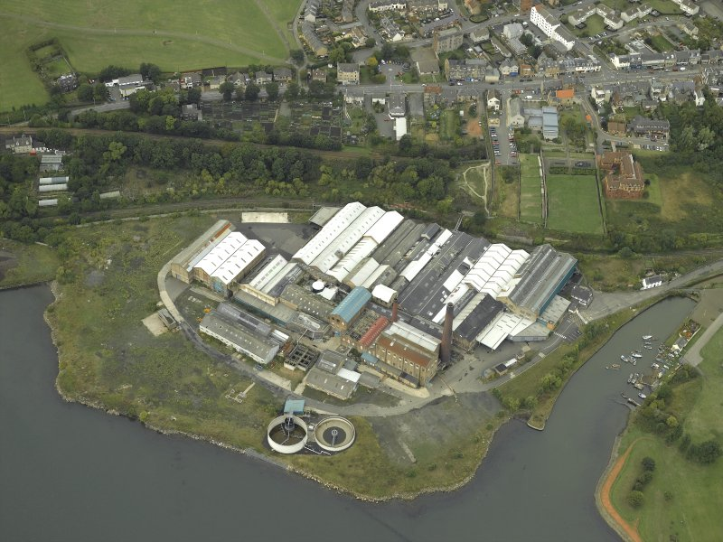 Oblique aerial view centred on the paper mill and saltworks, taken from the ESE.
