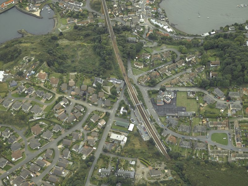 Oblique aerial view of the village centred on the railway station and school, taken from the N.
