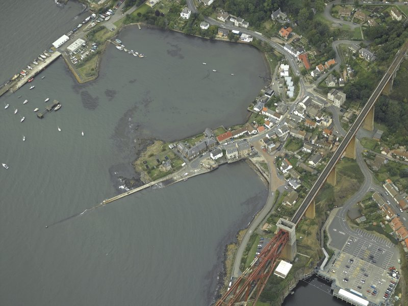 Oblique aerial view centred on the harbour, taken from the SE.