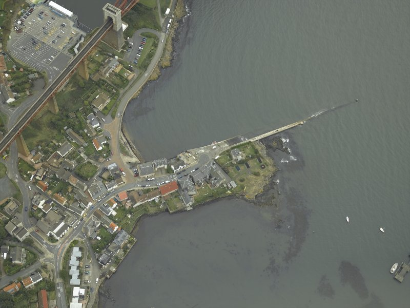 Oblique aerial view centred on the pier and the hotel, taken from the NW.