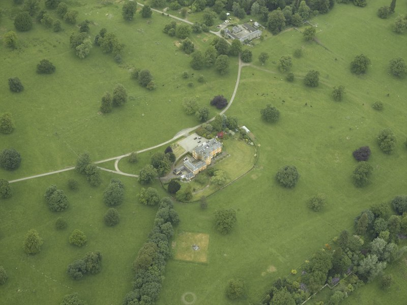 Oblique aerial view centred on the country house, stable block and walled garden, taken from the S.