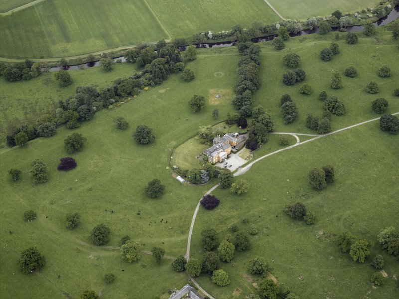 Oblique aerial view centred on the country house and walled garden, taken from the N.