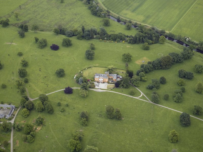 Oblique aerial view centred on the country house and walled garden, taken from the NW.