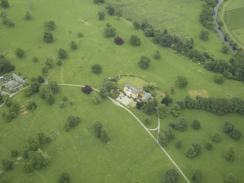 Oblique aerial view centred on the country house and walled garden, taken from the W.