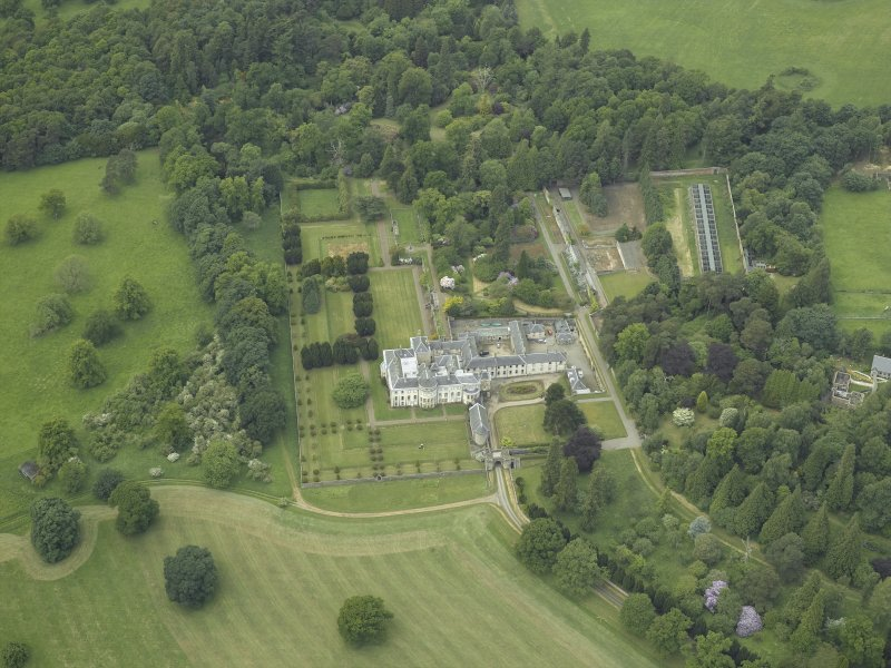 Oblique aerial view centred on the country house, walled garden, gardens and terraces, taken from the ESE.