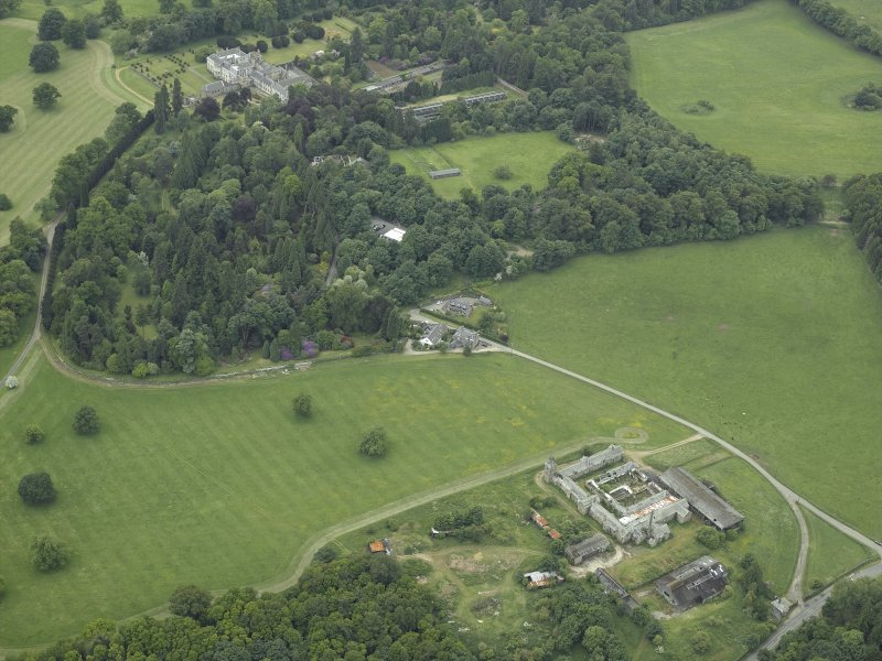 General oblique aerial view centred on the farmsteading and stallion house with the country house adjacent, taken from the NE.