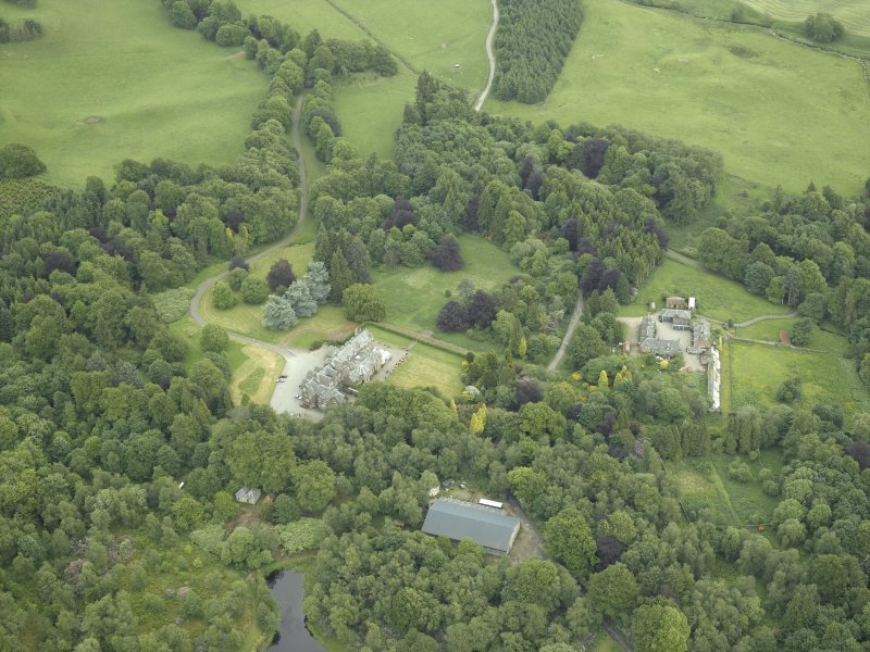 Oblique aerial view centred on the country house, walled garden and farmsteading, taken from the NW.