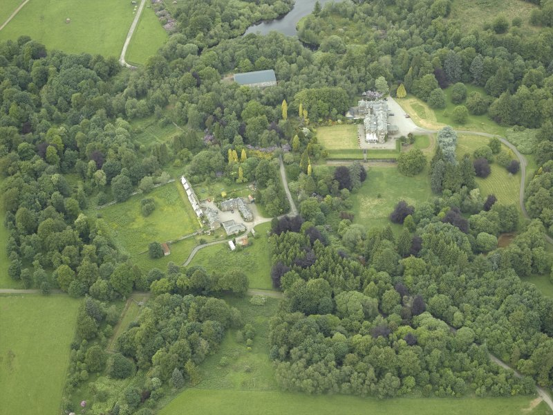 Oblique aerial view centred on the country house, walled garden and farmsteading, taken from the S.