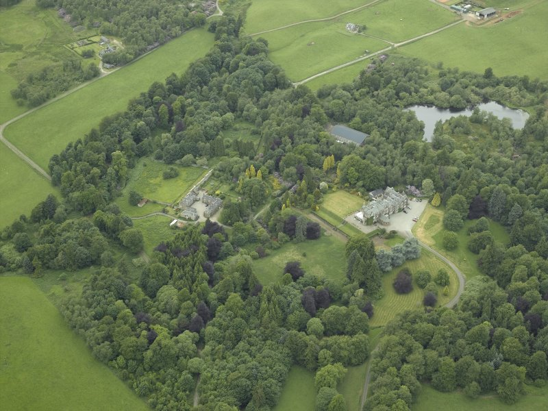 General oblique aerial view centred on the country house, walled garden and farmsteading, taken from the E.