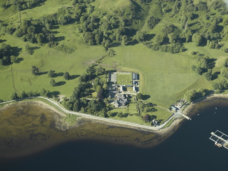 Oblique aerial view centred on the priory, house and pier, taken from the SW.